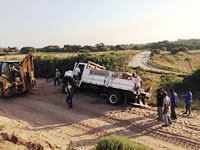 sub-Saharan - truck overturned on sand road